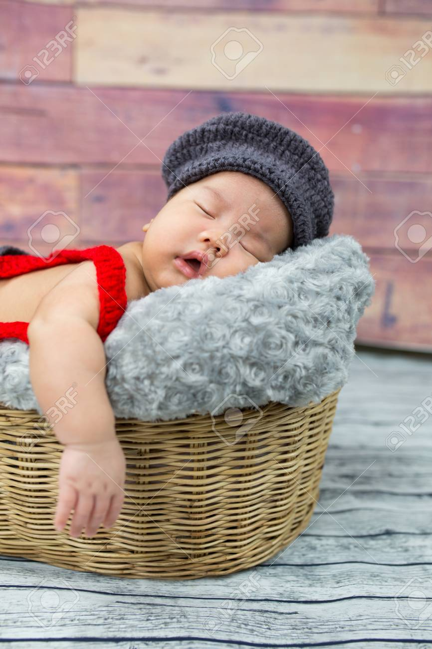 6 week old newborn boy sleeping in a basket