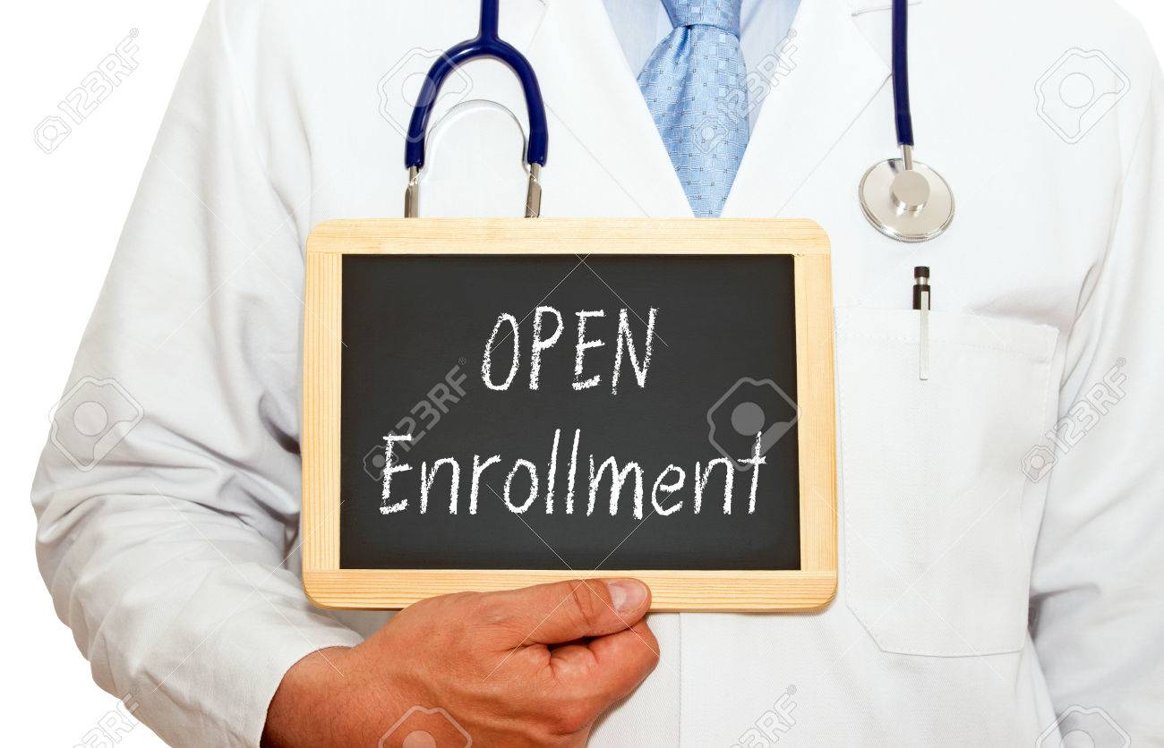 Open Enrollment - Doctor with chalkboard Stock Photo - 36740725
