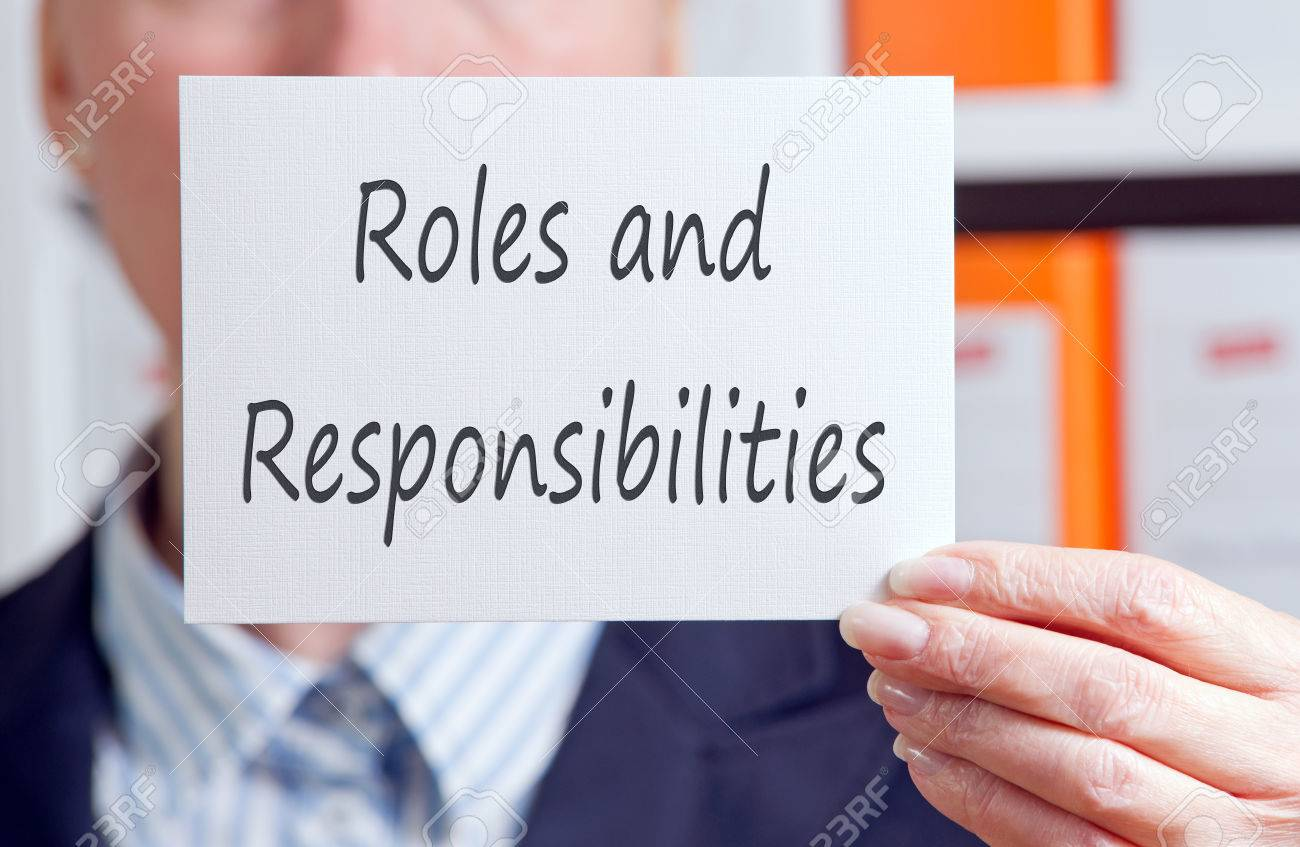 Roles and Responsibilities - business woman with sign - 71690733