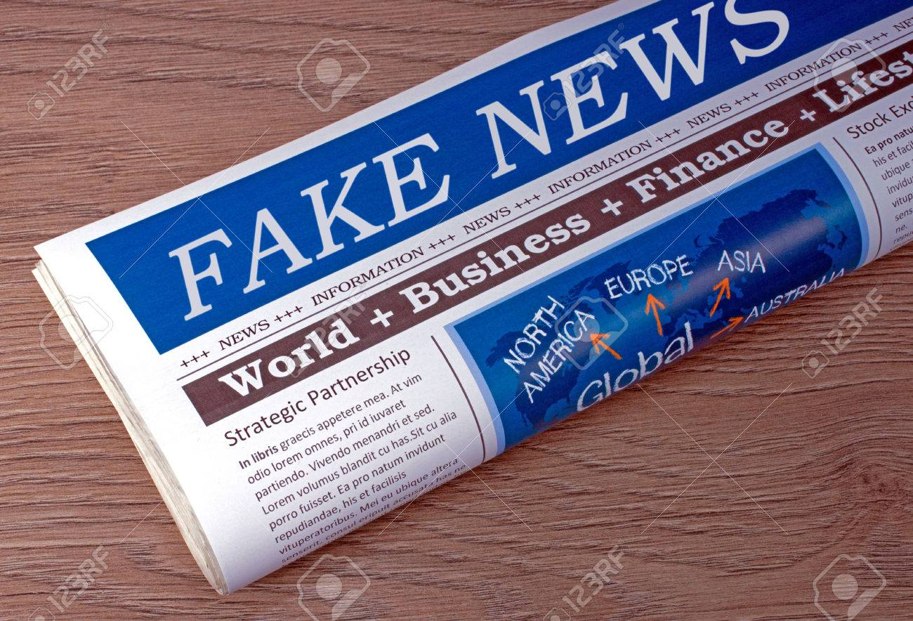 Fake News Newspaper on desk in the office - 72301270