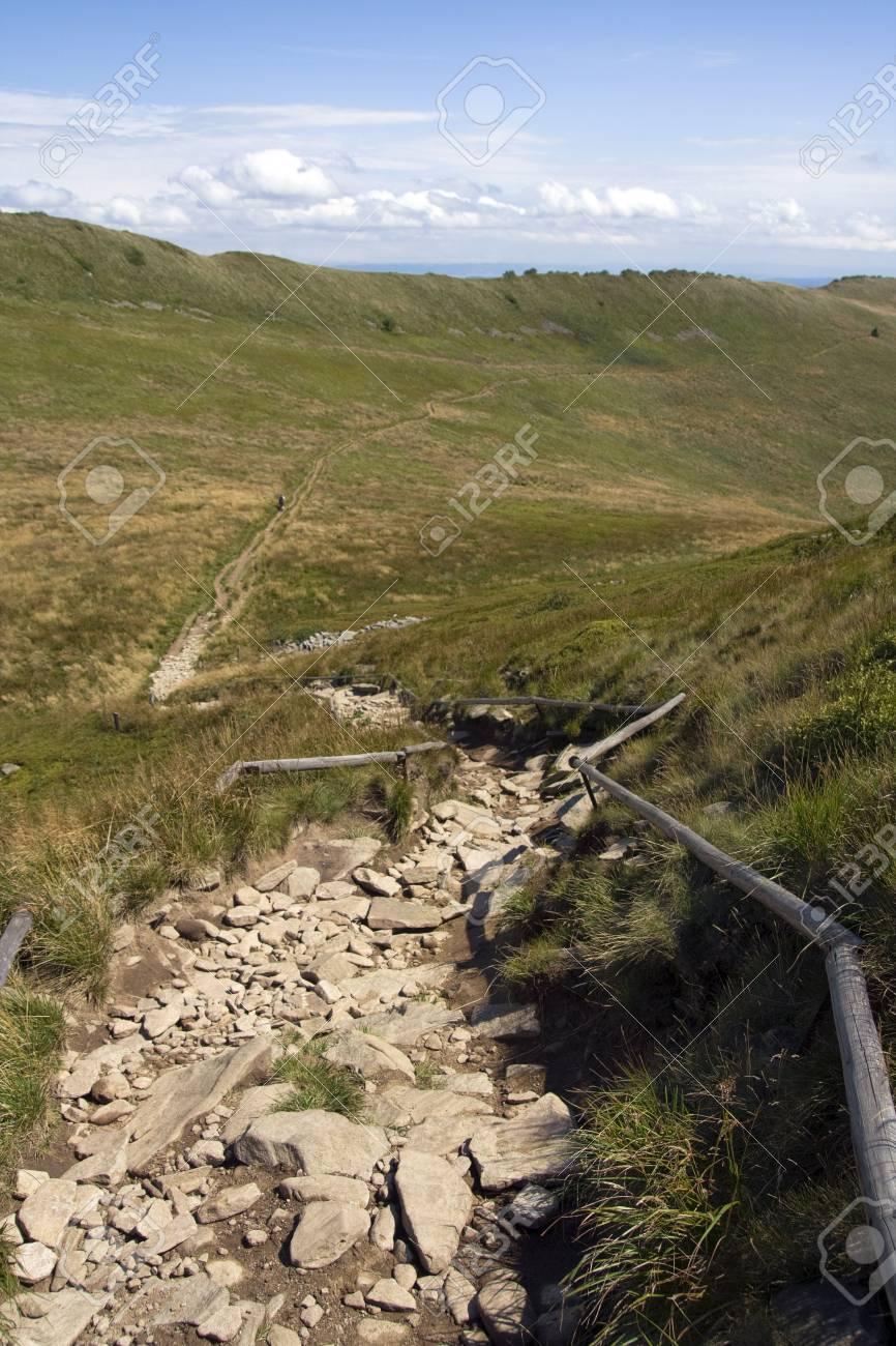 Stone, tourist trail in mountain among meadows Stock Photo - 3531898