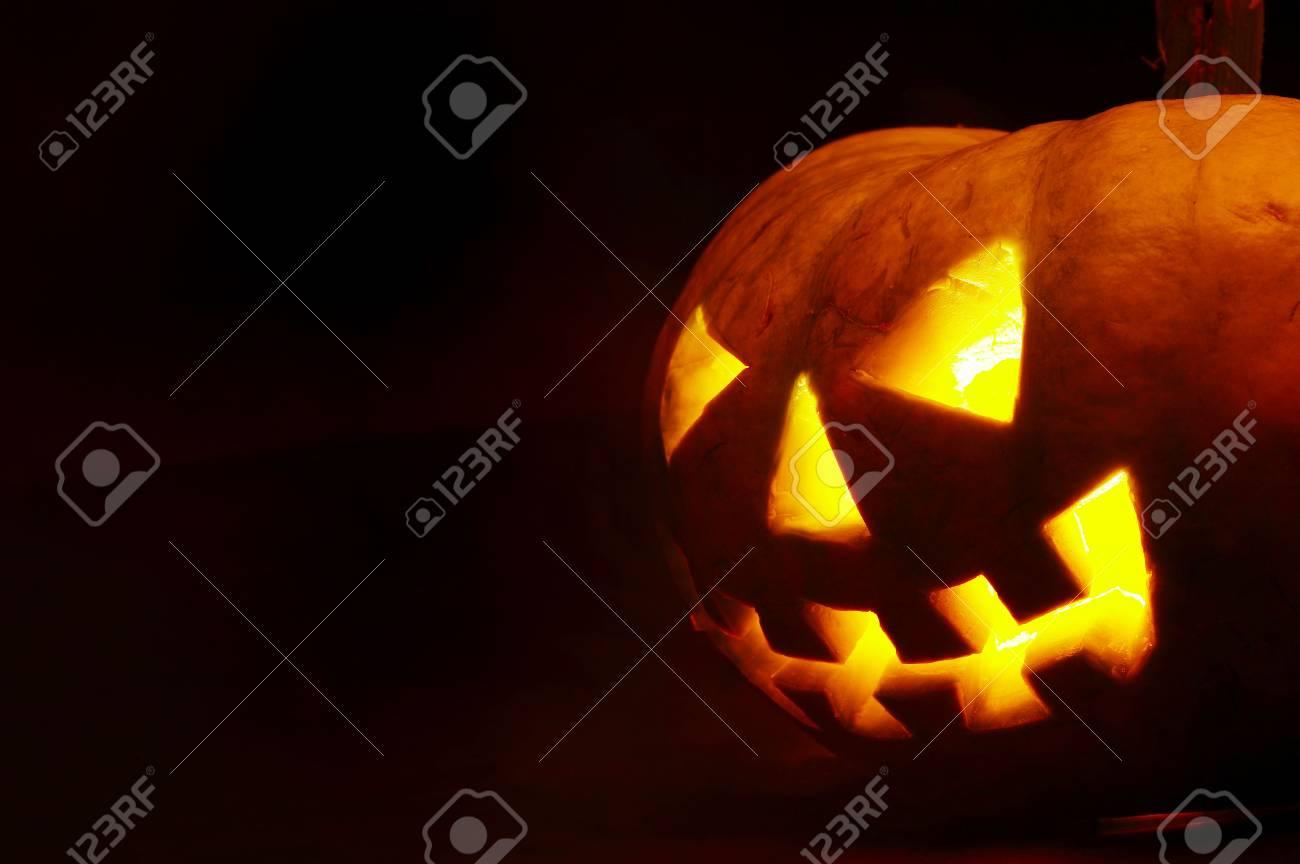 A scary old jack-o-lantern on black. Stock Photo - 2880265