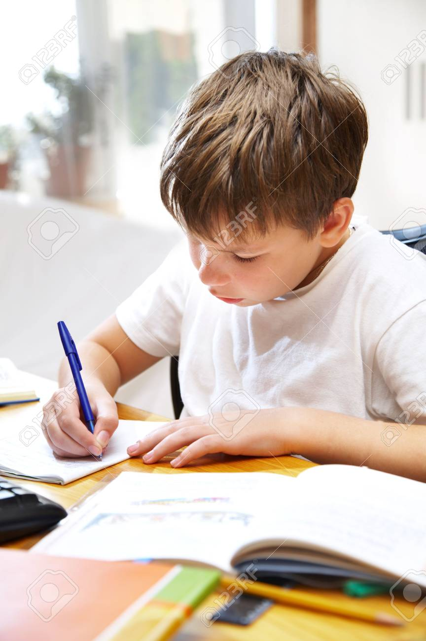 The boy behind a desk... Stock Photo - 3668906
