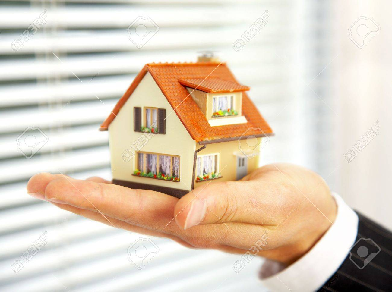 The house in human hands Stock Photo - 3668890