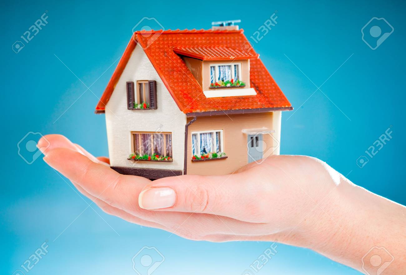 house in human hands on the blue Stock Photo - 6016336