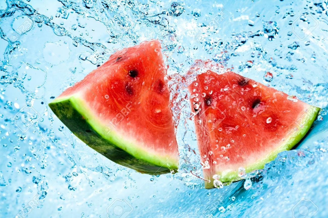 fresh water splash on red watermelon - 7308310