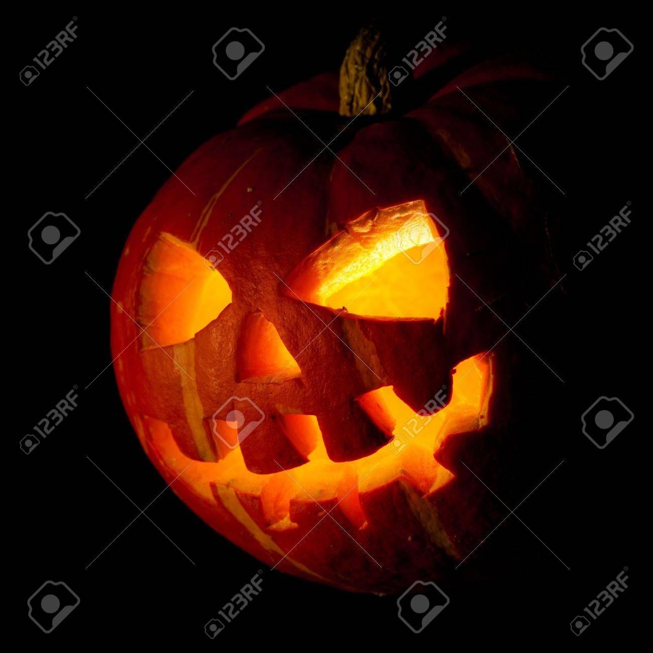 Scary old jack-o-lantern on black background. Stock Photo - 10763526