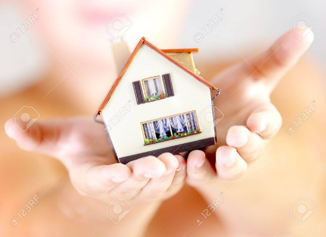The house in human hands Stock Photo - 12938625
