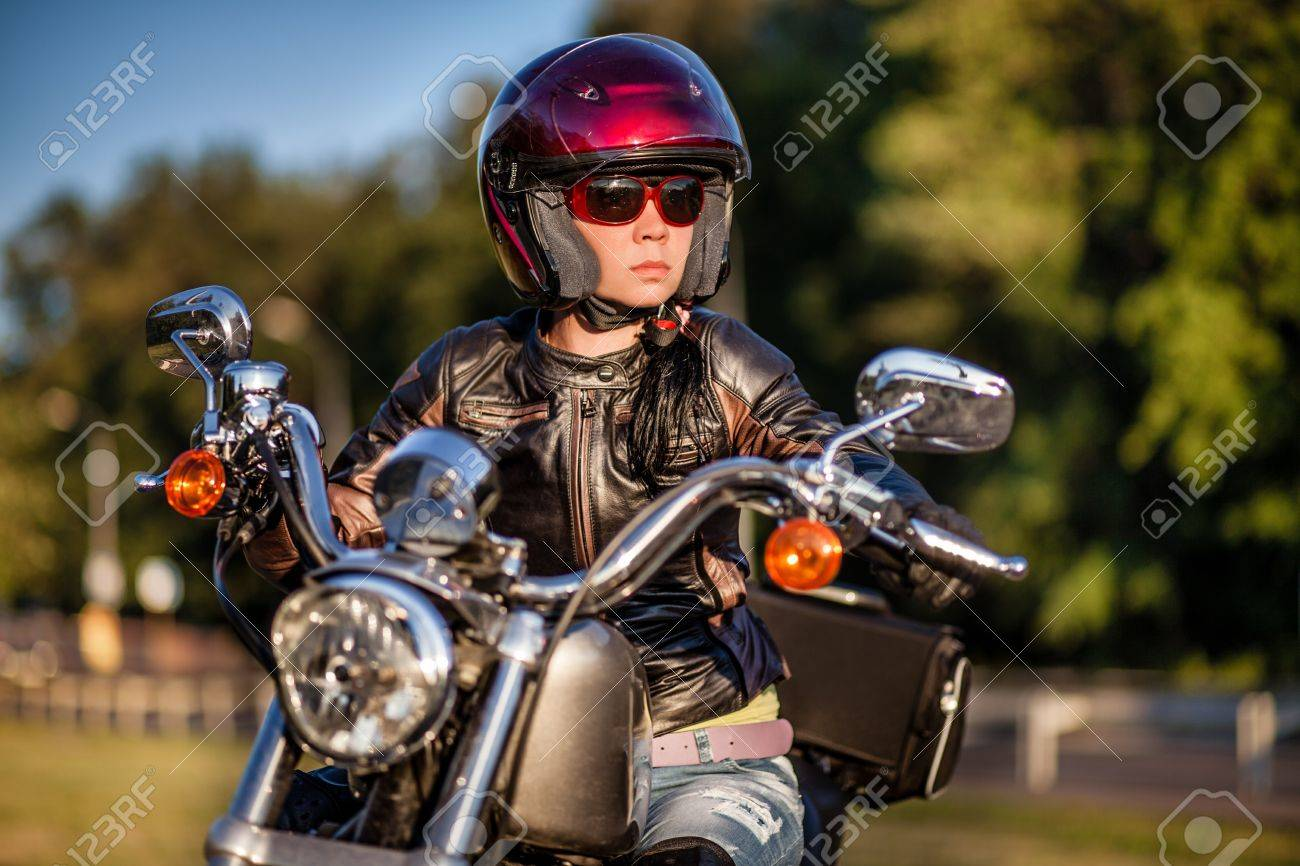 Biker girl sits on a motorcycle Stock Photo - 14736646