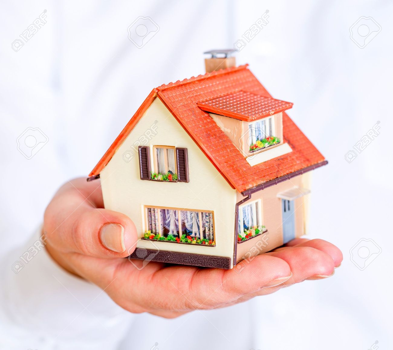 house in human hands on a white background Stock Photo - 18959899