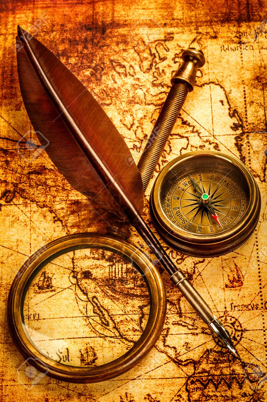 Vintage Magnifying Glass, Compass And Goose Quill Pen Lying On ...