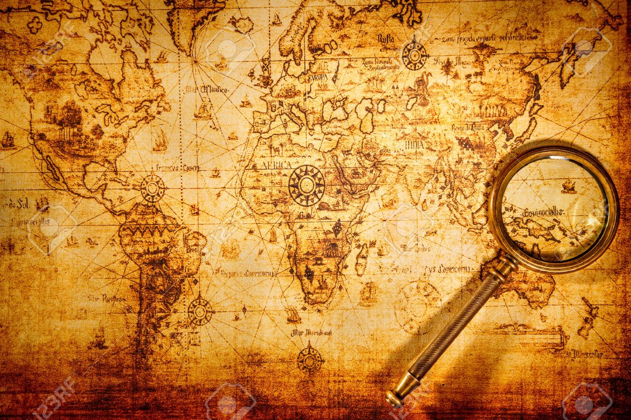 Vintage still life vintage magnifying glass lies on an ancient vintage magnifying glass lies on an ancient world map stock photo gumiabroncs Image collections