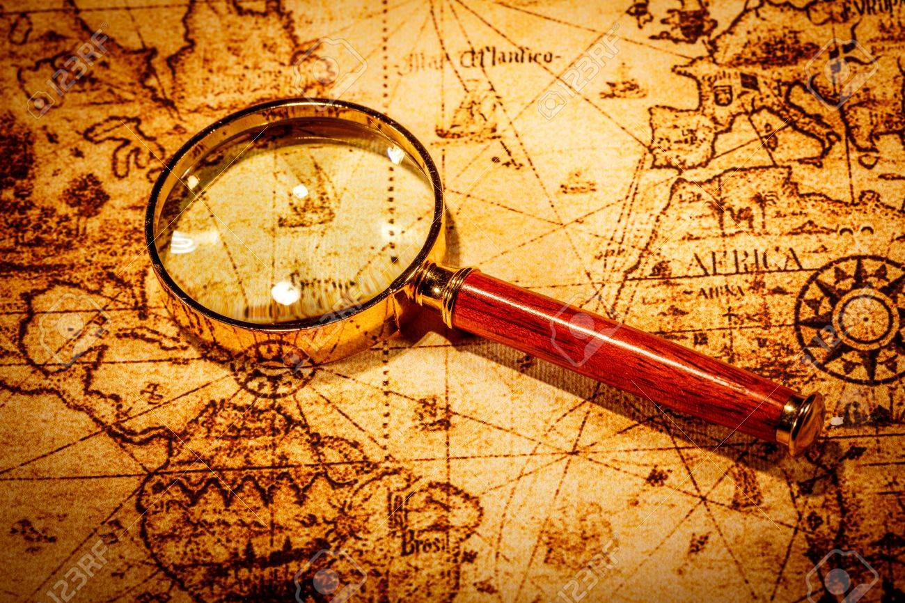 Vintage still life vintage magnifying glass lies on an ancient vintage magnifying glass lies on an ancient world map gumiabroncs Image collections