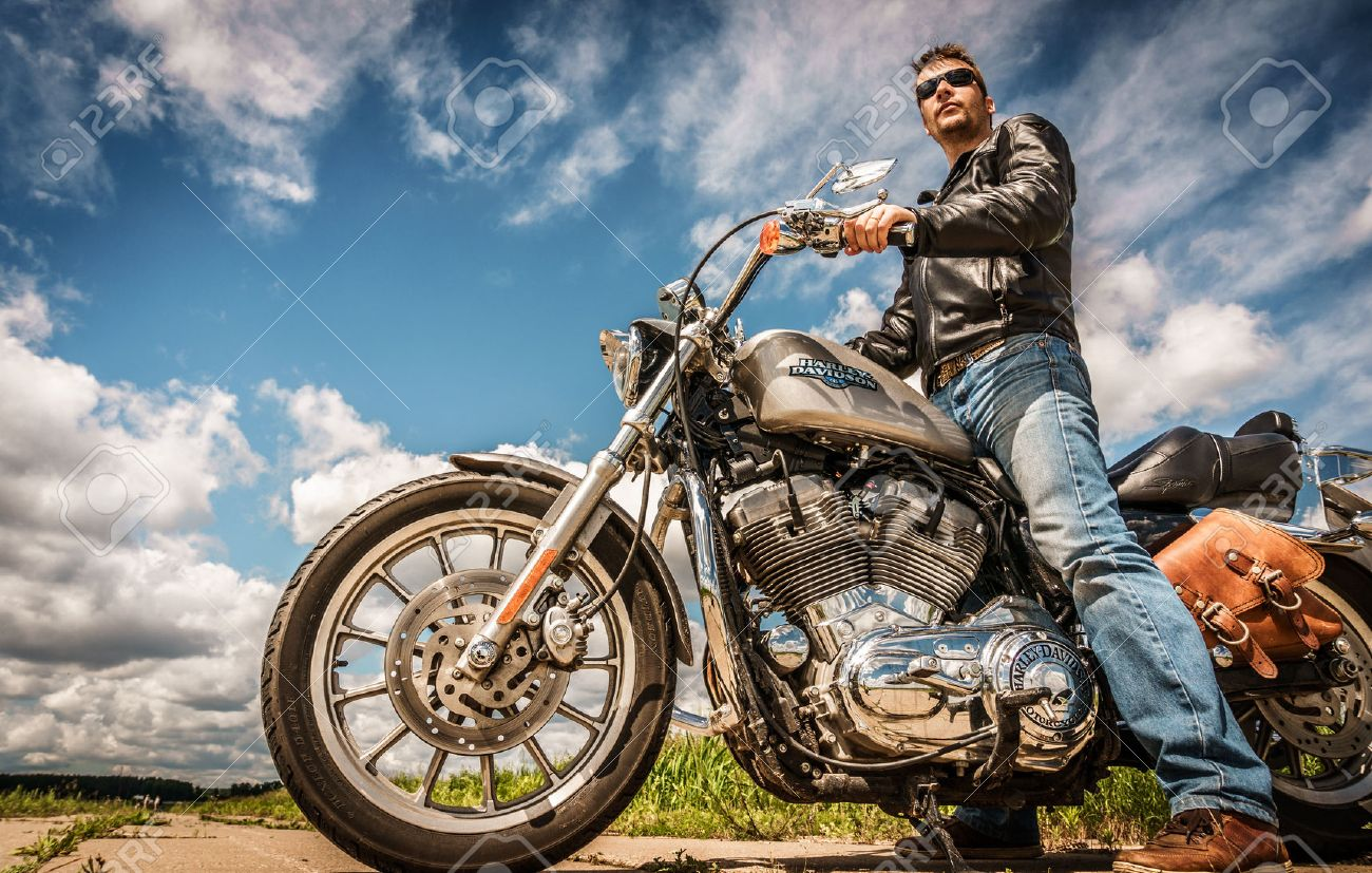 russia-july 7, 2013: biker on bike harley sportster. harley