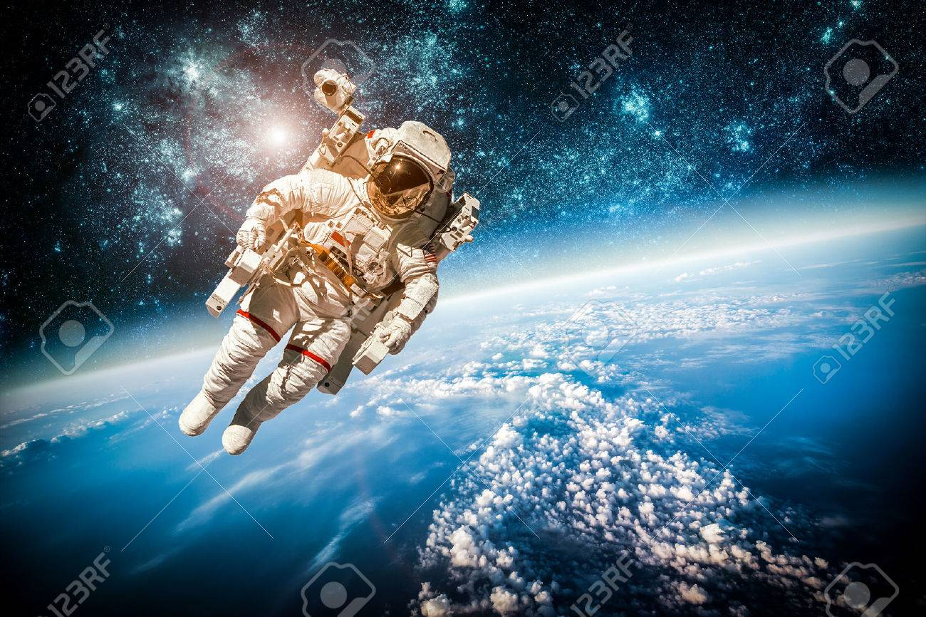Astronaut in outer space against the backdrop of the planet earth. - 35122778