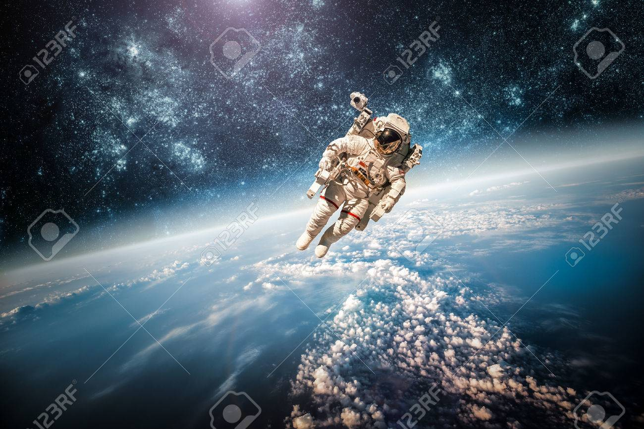 Astronaut in outer space against the backdrop of the planet earth. Elements of this image furnished by NASA. - 35122780
