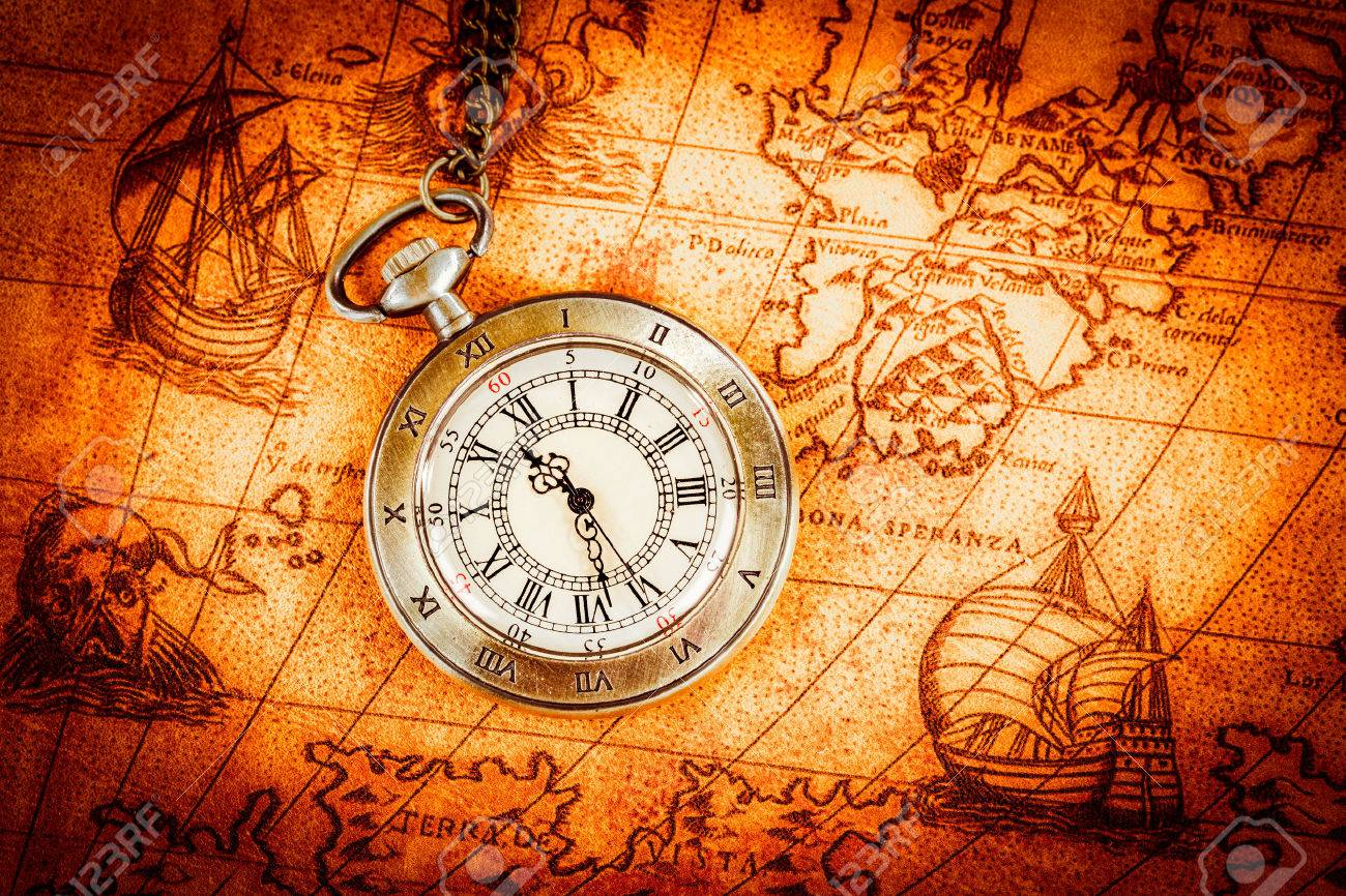 Vintage antique pocket watch on an ancient world map in 1565 stock stock photo vintage antique pocket watch on an ancient world map in 1565 gumiabroncs Gallery
