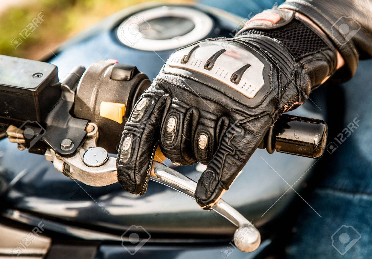 Motorcycle gloves metal - Human Hand In A Motorcycle Racing Gloves Holds A Motorcycle Throttle Control Hand Protection From
