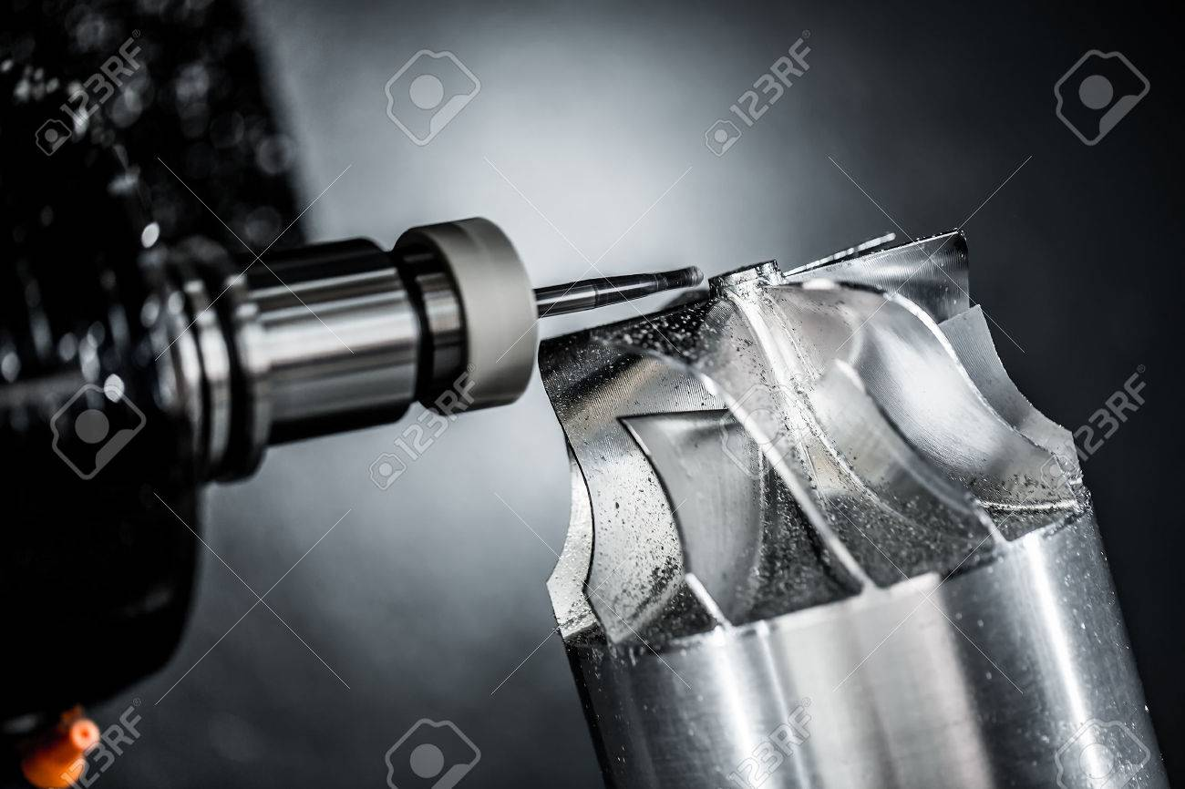 Metalworking CNC milling machine. Cutting metal modern processing technology. Small depth of field. Warning - authentic shooting in challenging conditions. A little bit grain and maybe blurred. - 40694242