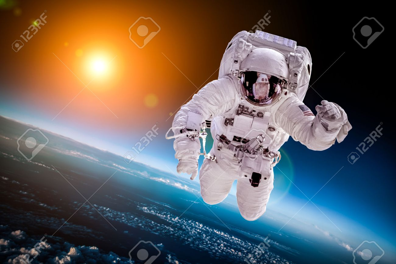 Astronaut in outer space against the backdrop of the planet earth - 43960884