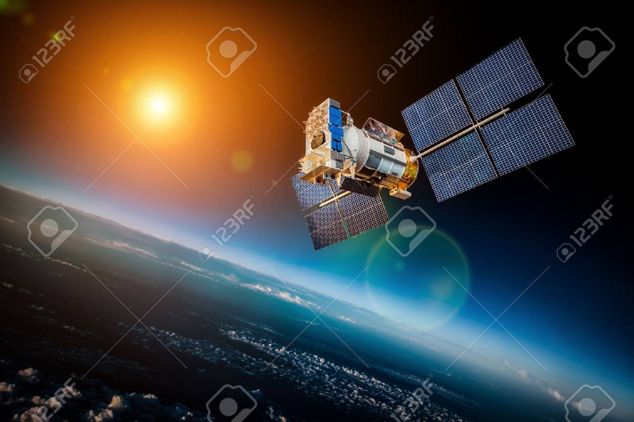 Space satellite orbiting the earth on a background star and sun Stock Photo - 43959582
