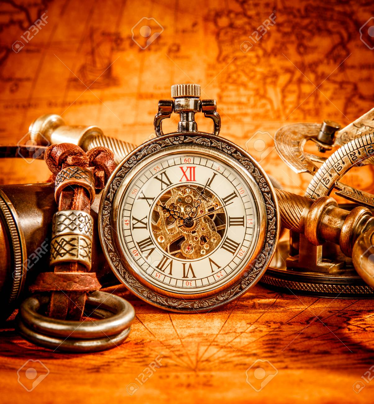 Vintage antique pocket watch on an ancient world map in 1565 stock stock photo vintage antique pocket watch on an ancient world map in 1565 gumiabroncs Image collections