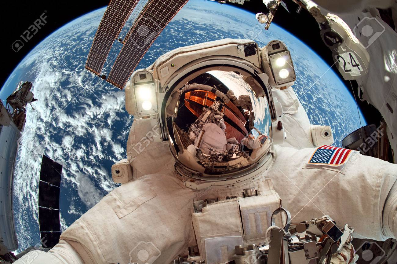 International Space Station And Astronaut In Outer Over The Planet Earth Stock Photo