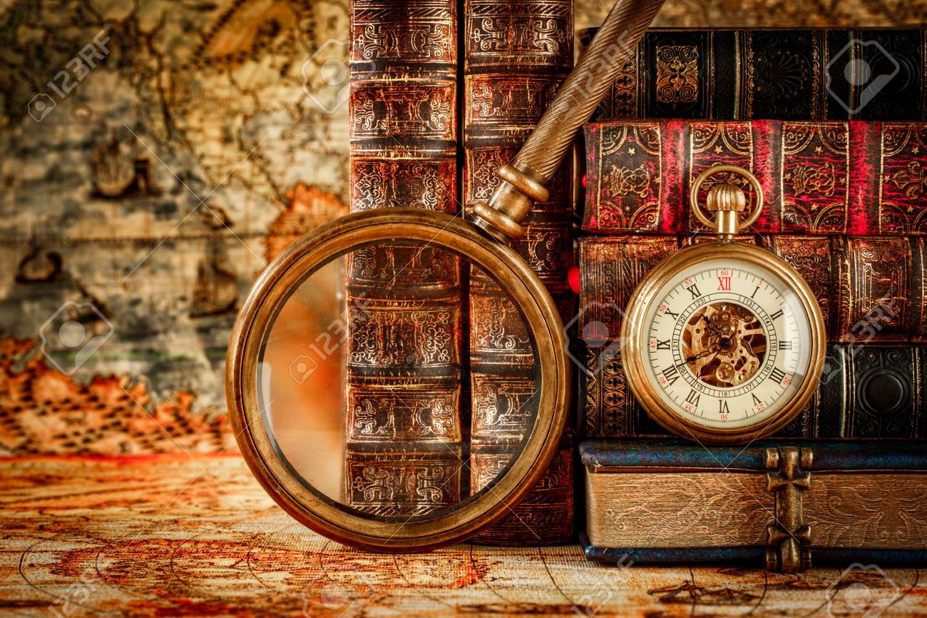 Vintage Antique pocket watch on the background of old books - 54767018