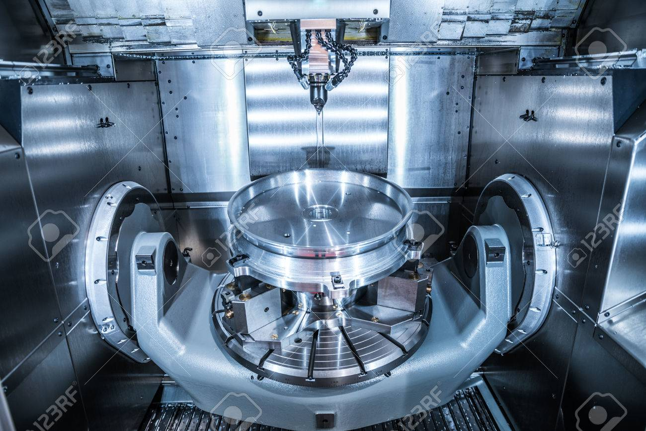 Metalworking CNC milling machine. Cutting metal modern processing technology. Small depth of field. Warning - authentic shooting in challenging conditions. A little bit grain and maybe blurred. - 57580622