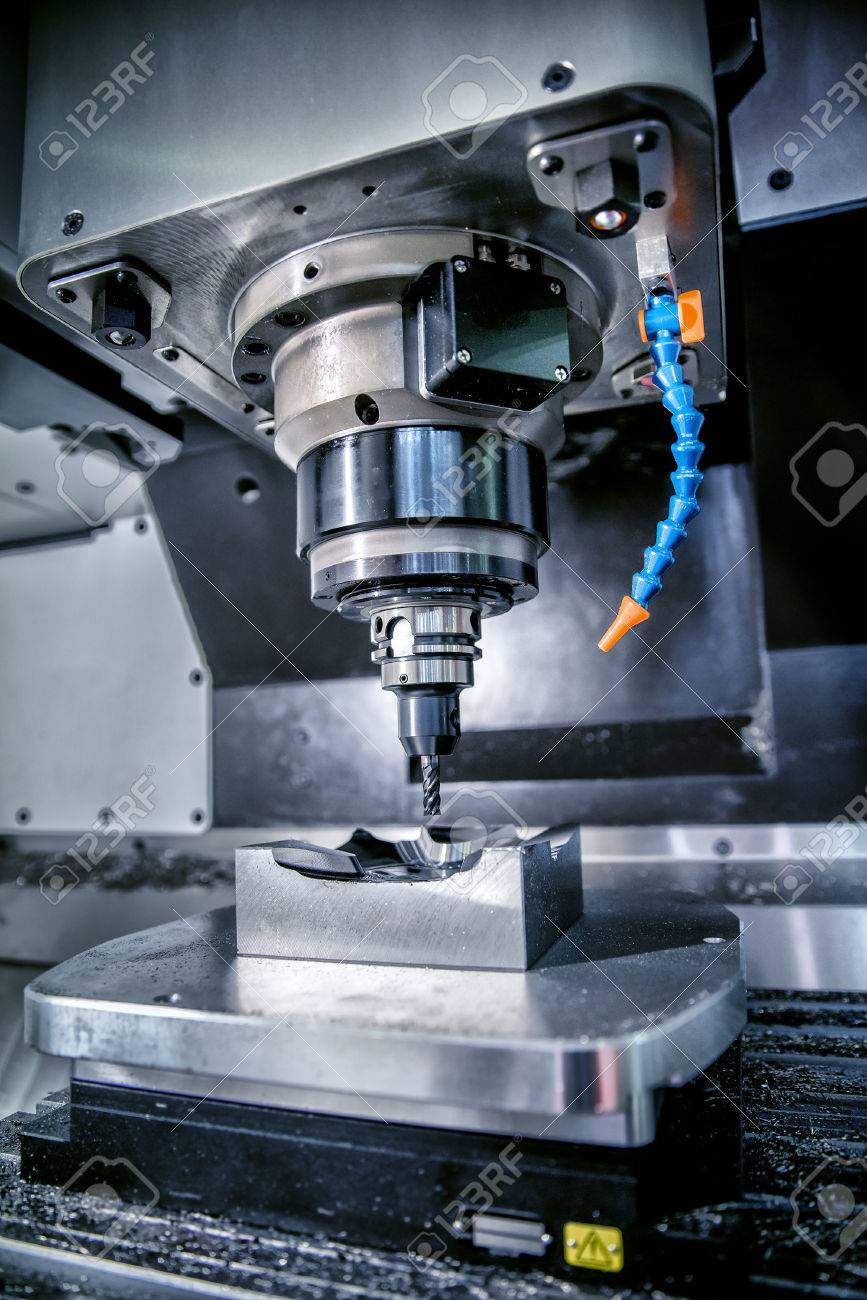 Metalworking CNC milling machine. Cutting metal modern processing technology. Small depth of field. Warning - authentic shooting in challenging conditions. A little bit grain and maybe blurred. - 57580656