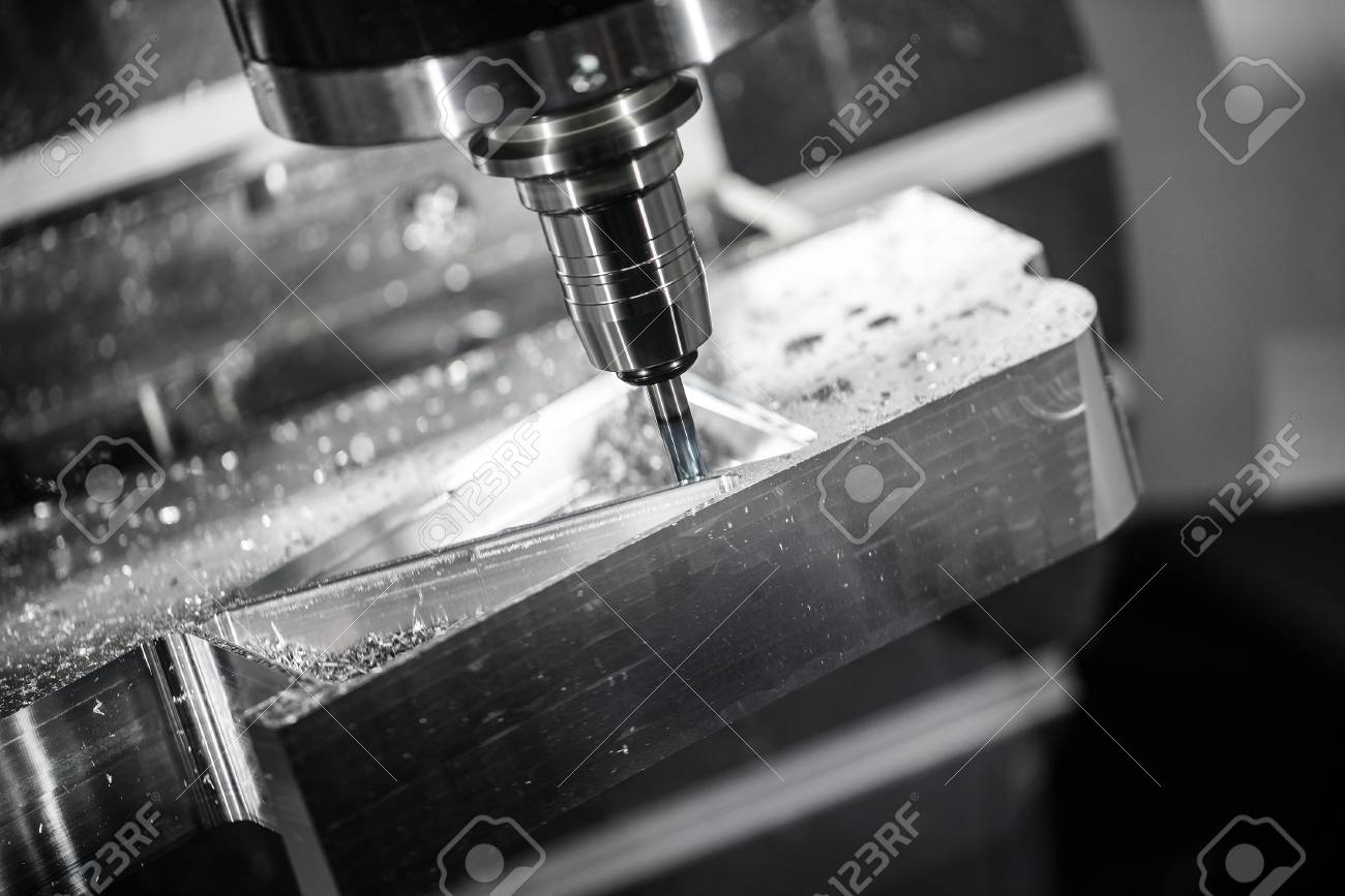 Metalworking CNC milling machine. Cutting metal modern processing technology. Small depth of field. Warning - authentic shooting in challenging conditions. A little bit grain and maybe blurred. - 57580709