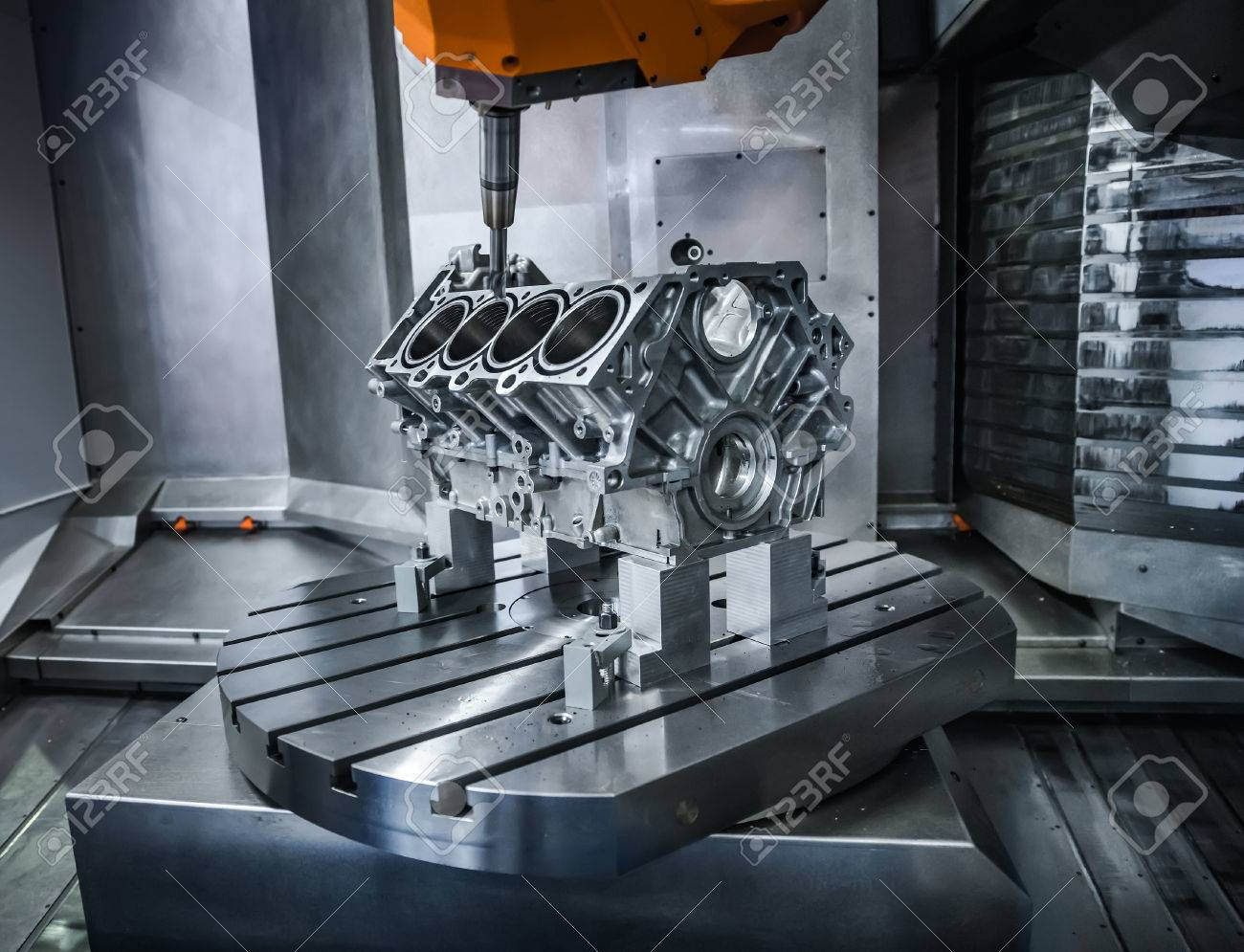 Metalworking CNC milling machine. Cutting metal modern processing technology. Small depth of field. Warning - authentic shooting in challenging conditions. A little bit grain and maybe blurred. - 57580711