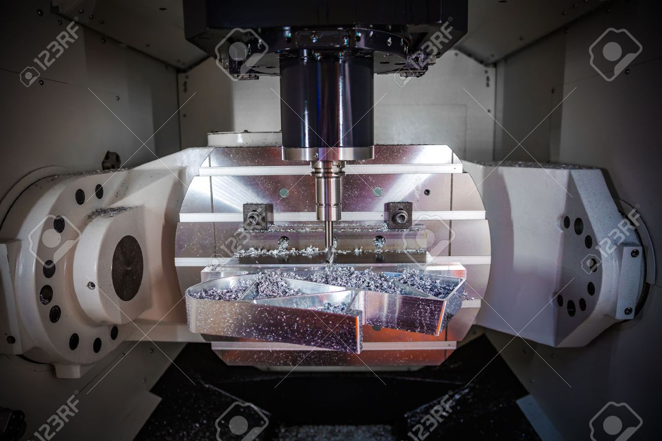 Metalworking CNC milling machine. Cutting metal modern processing technology. Small depth of field. Warning - authentic shooting in challenging conditions. A little bit grain and maybe blurred. - 64786625