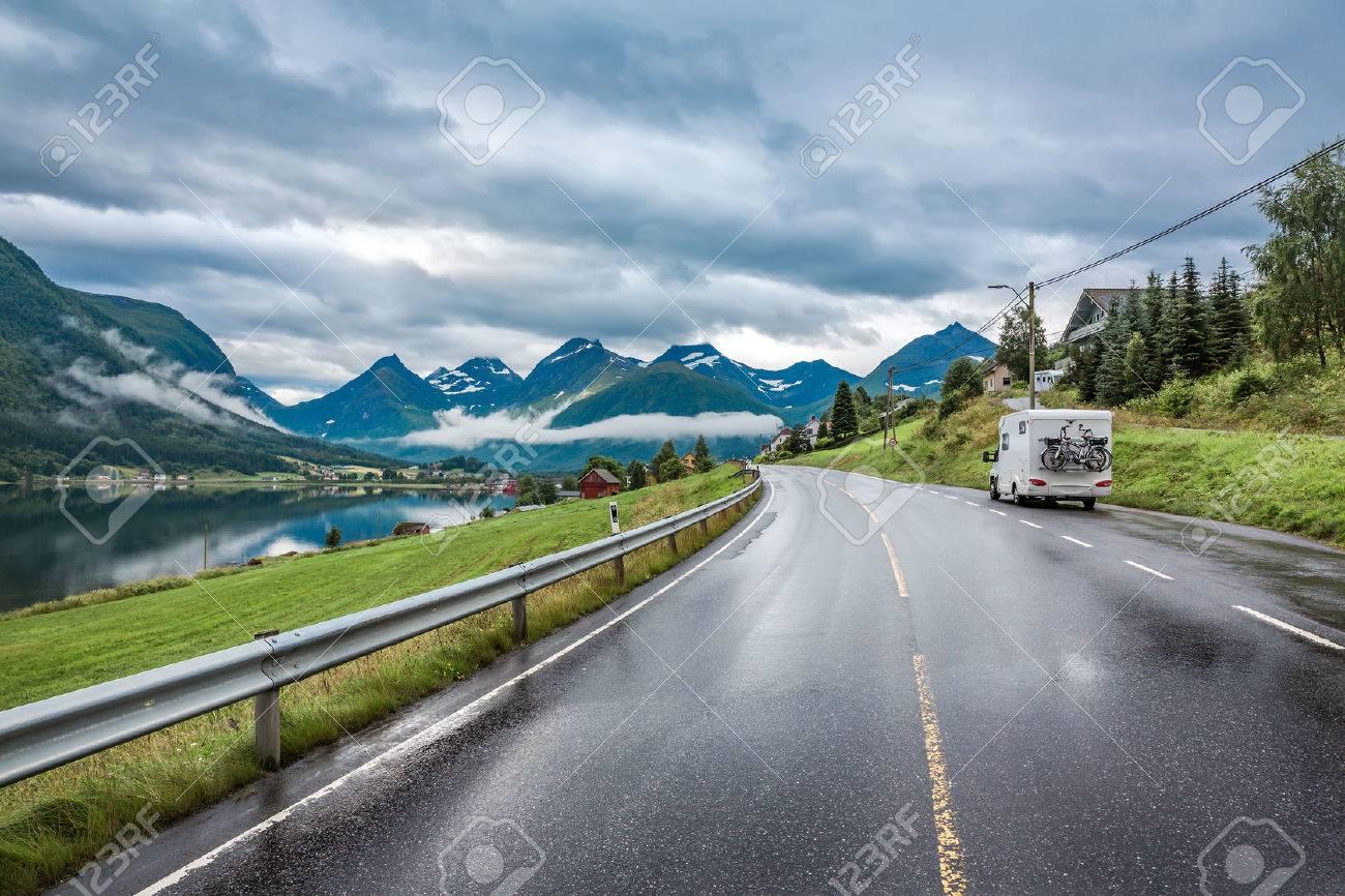 Caravan car travels on the highway. - 67035428