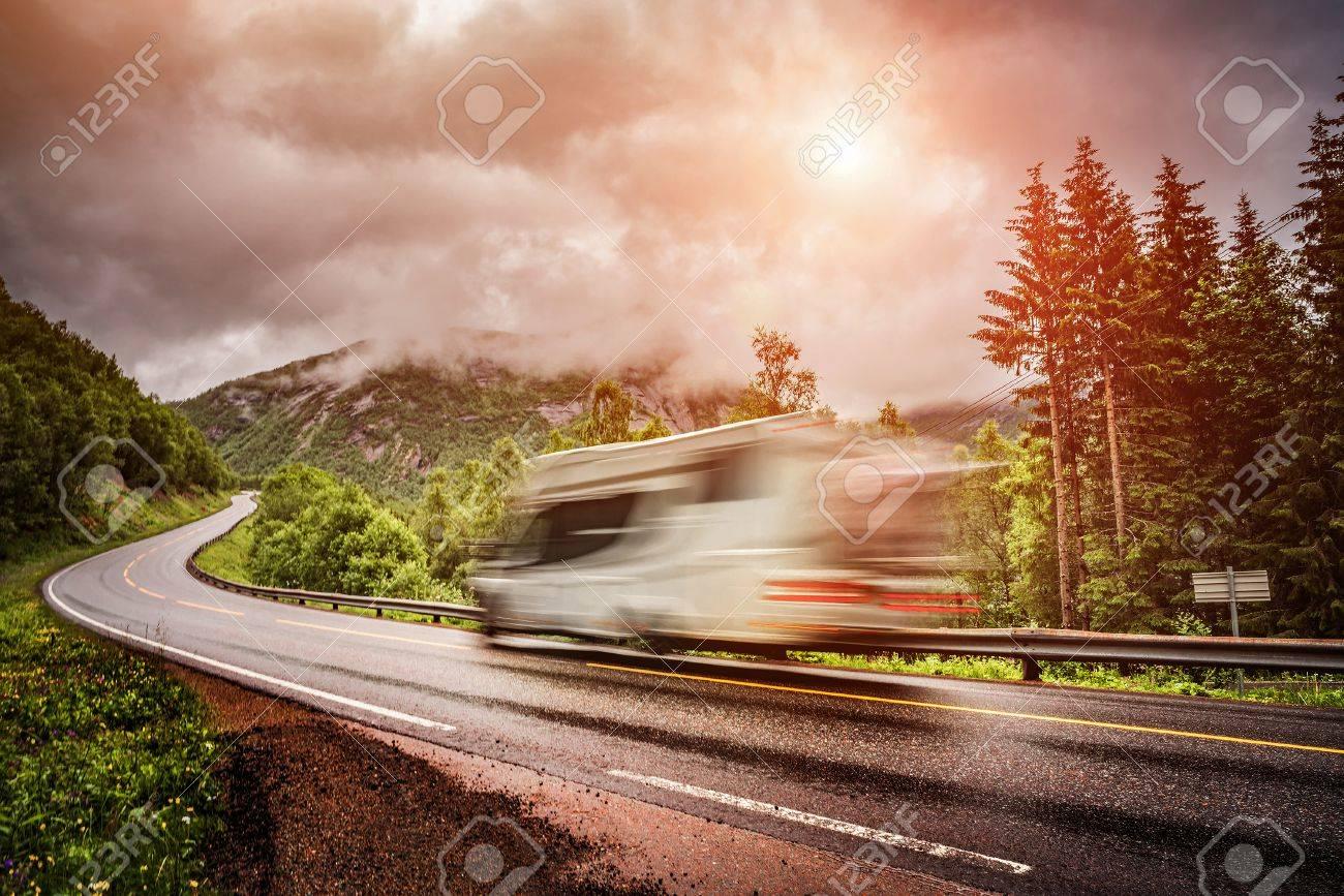 Caravan car travels on the highway. Caravan Car in motion blur. Filter applied in post-production. - 64786815
