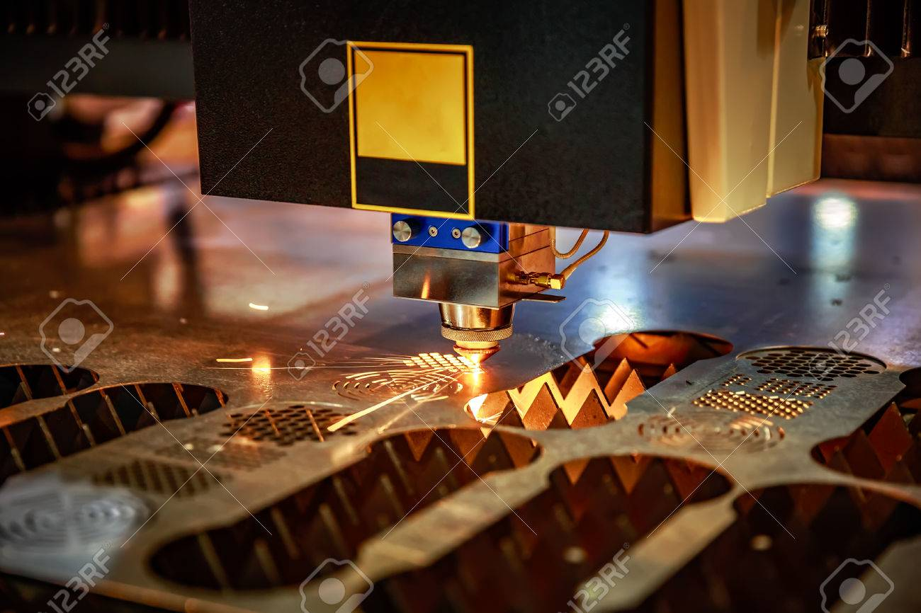 CNC Laser cutting of metal, modern industrial technology. . Small depth of field. Warning - authentic shooting in challenging conditions. A little bit grain and maybe blurred. - 71837456