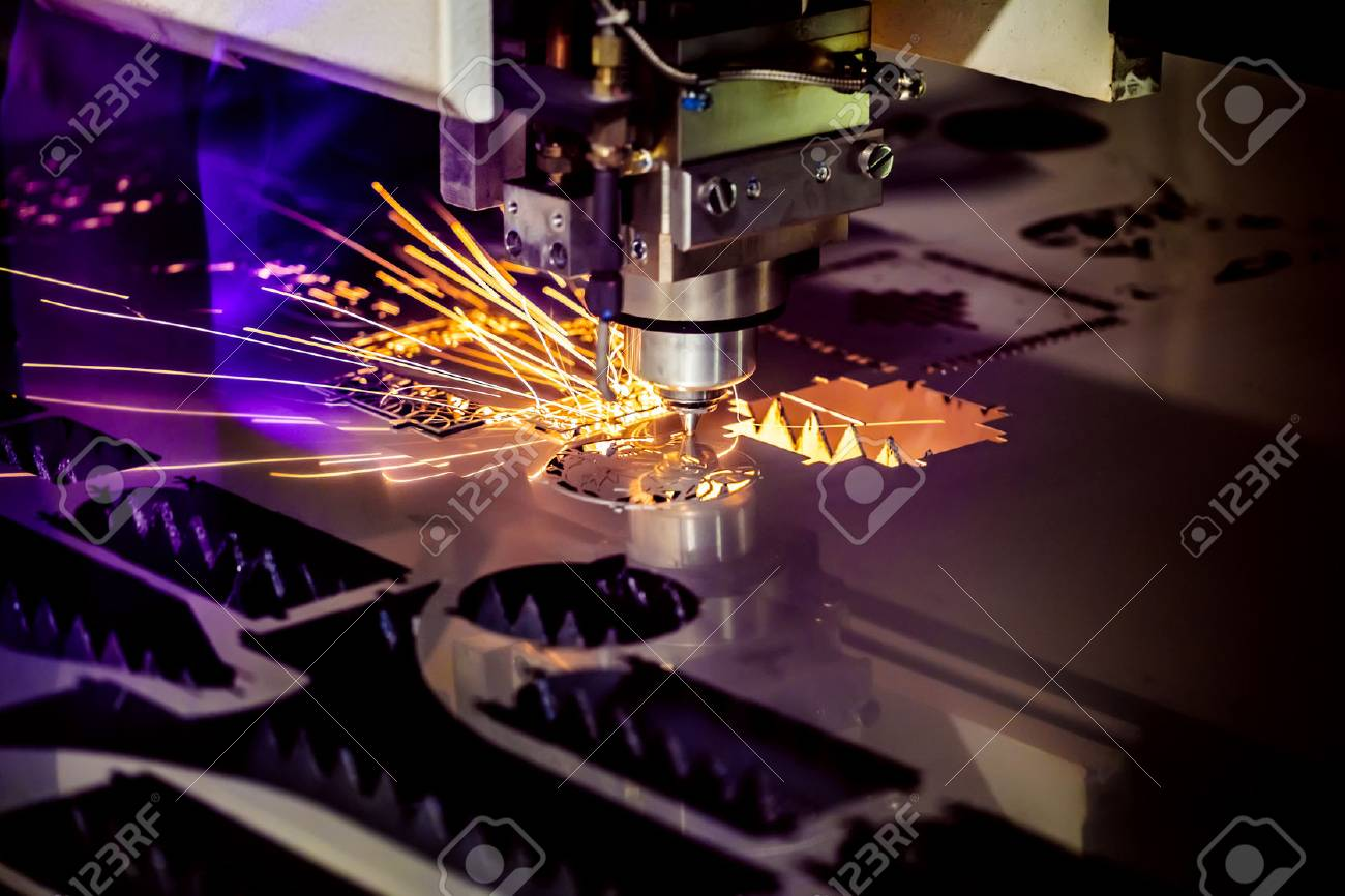 CNC Laser cutting of metal, modern industrial technology. Small depth of field. Warning - authentic shooting in challenging conditions. A little bit grain and maybe blurred. - 78593872