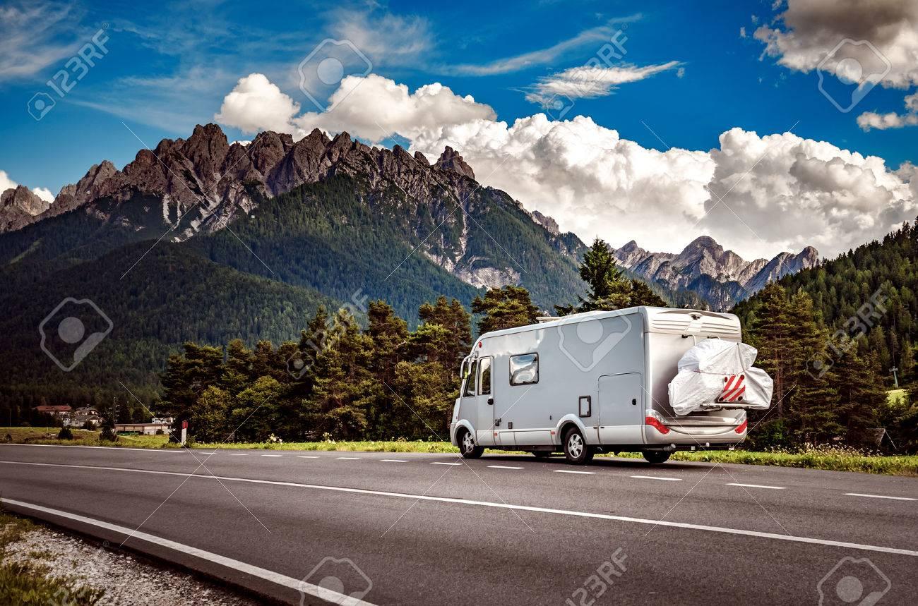 Family vacation travel, holiday trip in motorhome, Caravan car Vacation. Beautiful Nature Italy natural landscape Alps. - 84356399