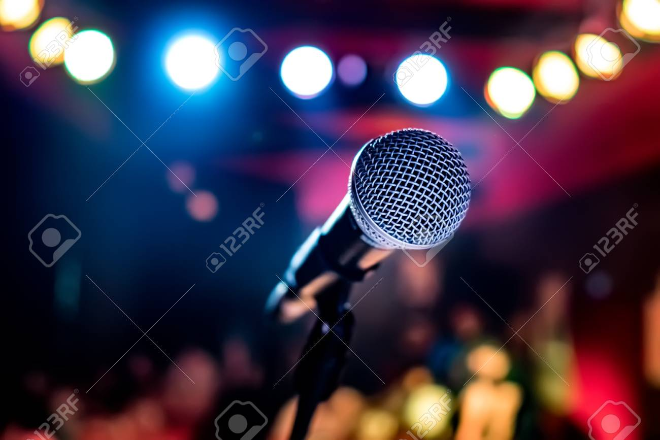 Public performance on stage Microphone on stage against a background of auditorium. Shallow depth of field. Public performance on stage. - 96106542