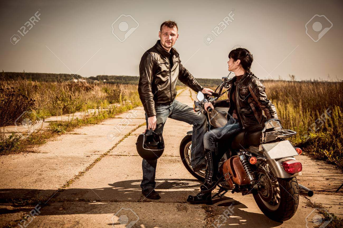 Bikers Couple Man And Woman Near A Motorcycle On The Road Stock Photo Picture And Royalty Free Image Image 98597680