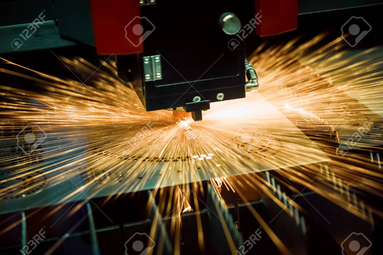CNC Laser cutting of metal, modern industrial technology. Small depth of field. Warning - authentic shooting in challenging conditions. - 120245403