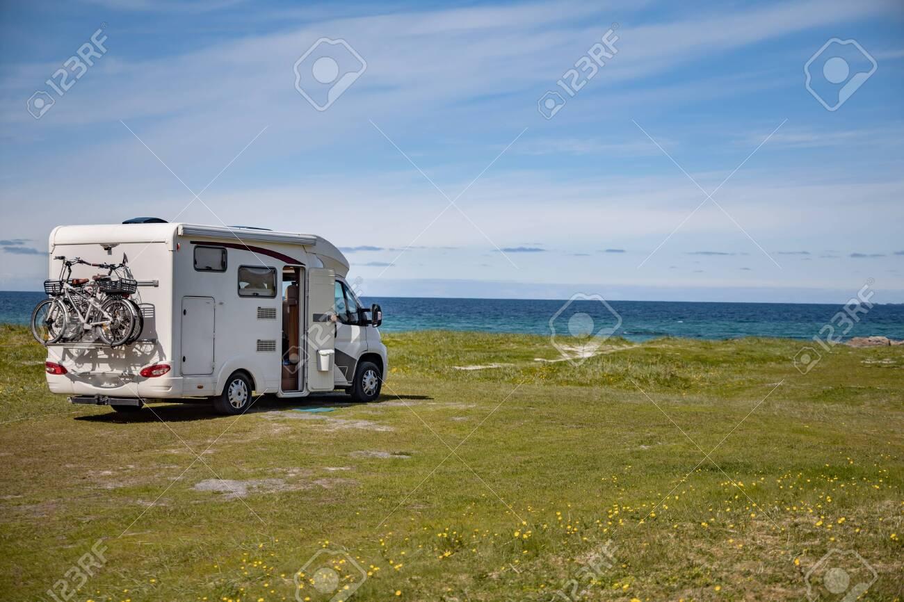 Family vacation travel RV, holiday trip in motorhome, Caravan car Vacation. Beautiful Nature Norway natural landscape. - 131394111