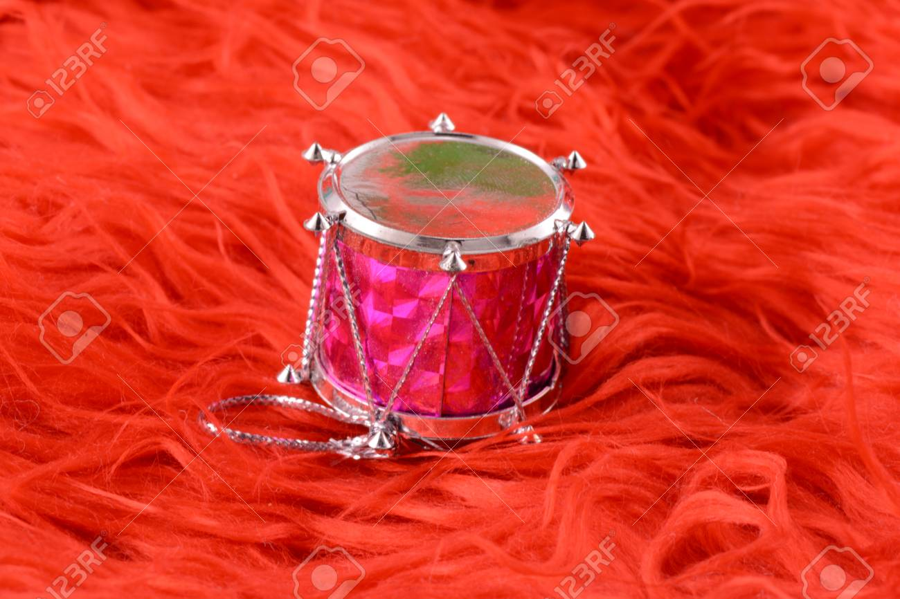 Christmas Drum.Christmas Toy Drum Isolated On Red Background