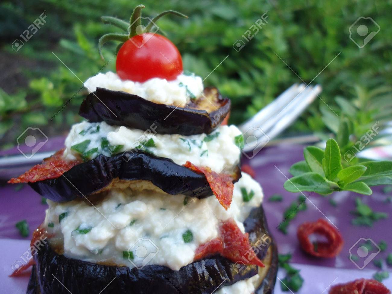 Vegan appetizer with eggplant, cashew cheese, chives and tomato leather Stock Photo - 22643163