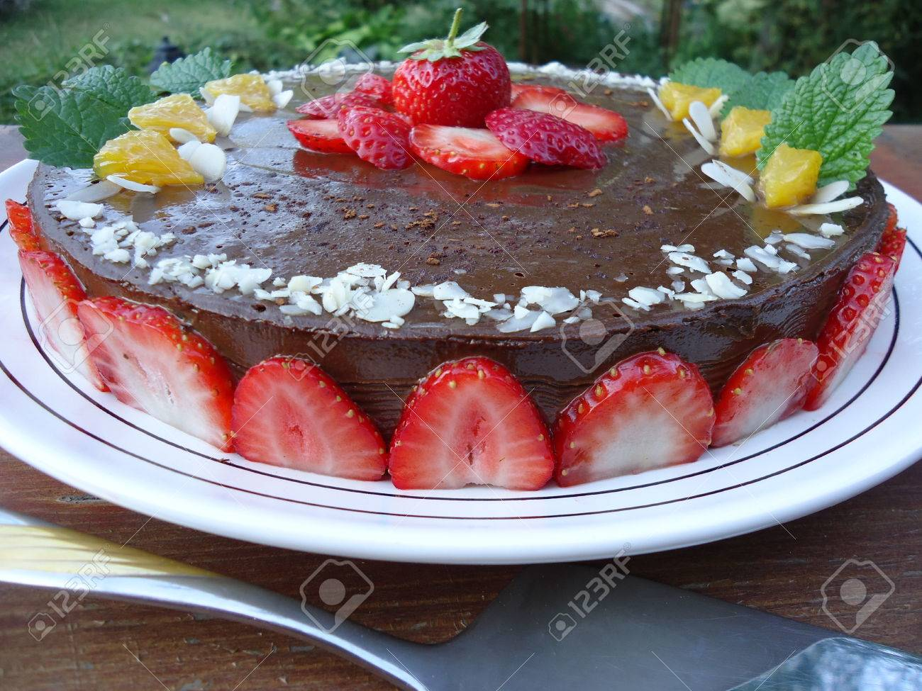 Raw vegan carob cake with strawberries Stock Photo - 22643181