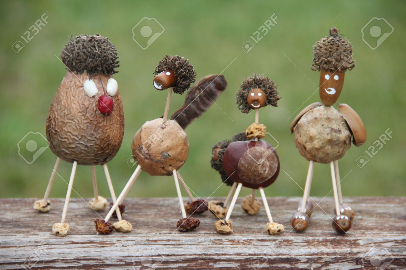 Funny characters hand made of forest nuts and seeds Stock Photo - 24600931