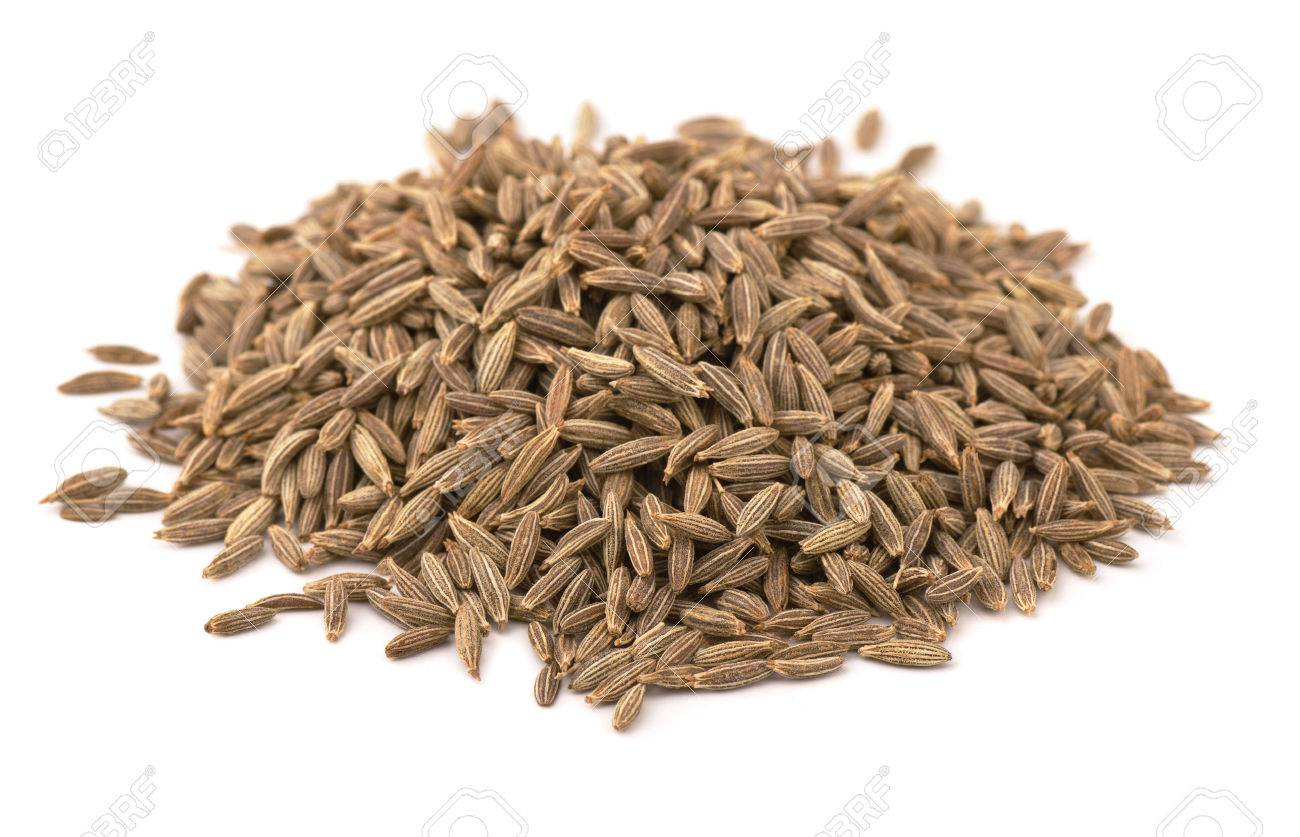 Heap of whole cumin seeds isolated on white - 25474099