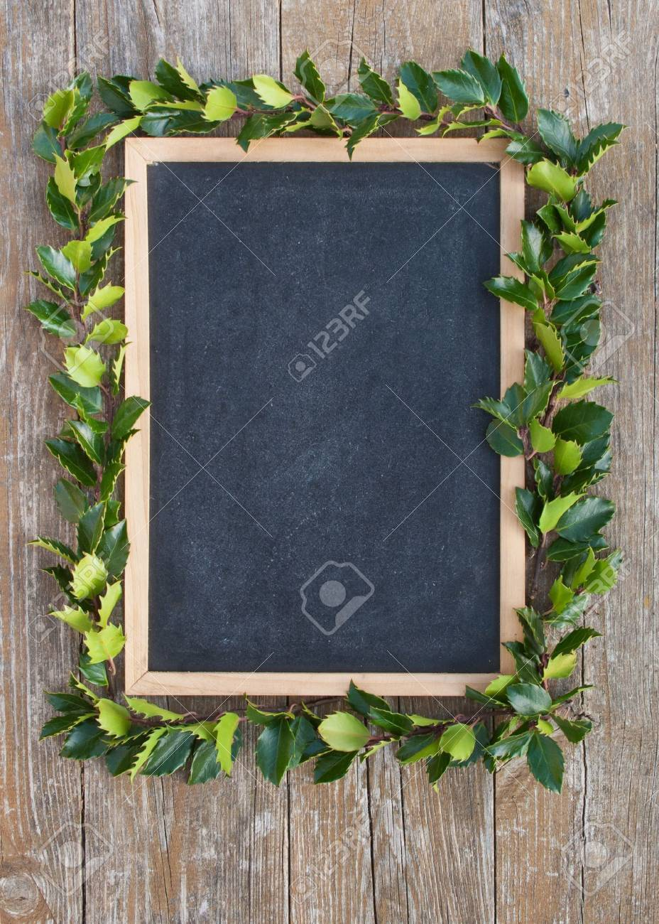 blackboard with holly branches Stock Photo - 16672231