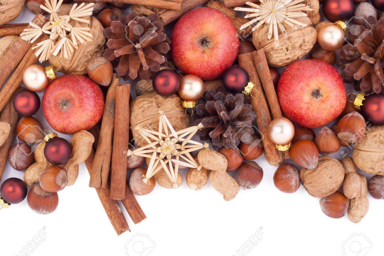 nuts, cinnamon, apples and christmas tree balls Standard-Bild - 16690681