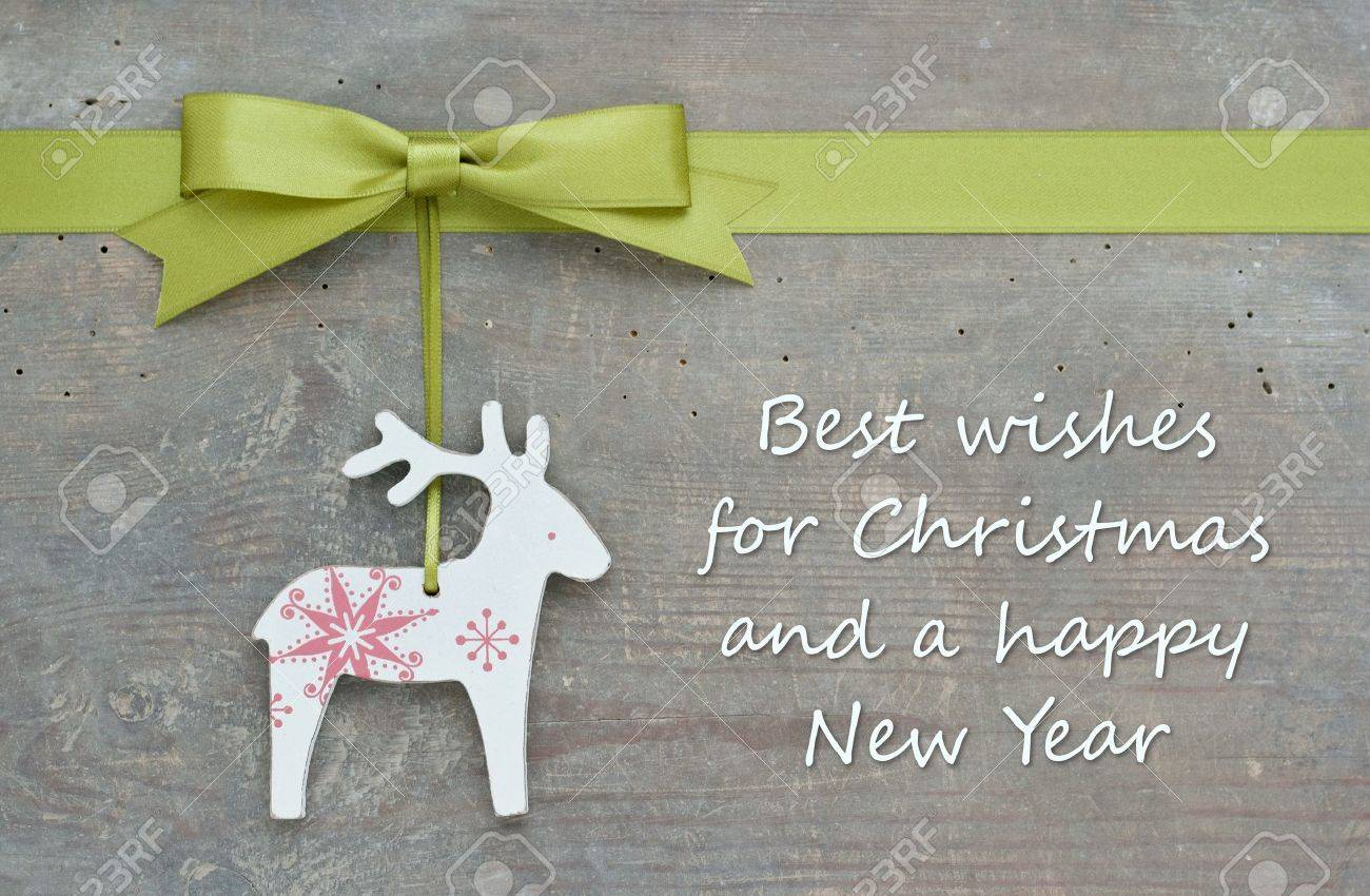 christmas card with reindeer and green bow Standard-Bild - 22071060